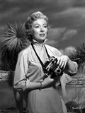 Greer Garson on a Long Sleeve Dress Holding a Camera