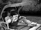 Claire Trevor Reclining on Couch  wearing White Long Sleeve with Magazine