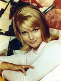 Carol Lynley wearing a Necklace and earrings