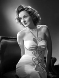 Constance Moore on a Tube Dress sitting and Bending