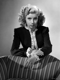 Gloria DeHaven Looking Serious Leaning On A Chair in Formal Dress in Black and White