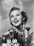 Colleen Gray Surrounded with Flowers Portrait