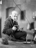 Beau Brummel in Black Coat with Cup