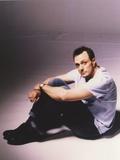 Hank Azaria Seated on Floor