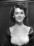 Barbara Rush smiling in Elegant Dress with Pearl Necklace