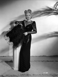 Claire Trevor Posed in Black Dress while Holding Black Pillow