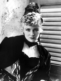 Claire Trevor Posed in Black Dress with Curly Hair Style