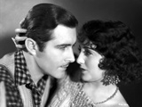 Bebe Daniels Ready to Kiss the Man in Polka Dot Collar Shirt while Holding His Head