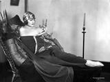 Betty Blythe Lying on the Black Reclining Bed in Black Strapless Sheer Sleeve Velvet Dress and Cott