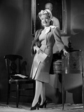 Gloria DeHaven Leaning On A Table in Formal Dress in Black and White