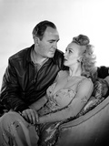 Carole Landis sitting on a Chair With Man