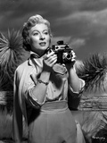 Greer Garson on a Silk Dress Holding a Camera