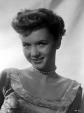 Debbie Reynolds smiling in White Dress with Pearl Choker