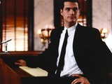 Chris O'Donnell Looking Away in Black Suit with One Hand on Hips