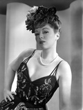 Claire Trevor Posed in Black Corset with Floral Hat