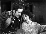 Bebe Daniels Leaning Back Her Head on the Man's Shoulder in Knitted Dress
