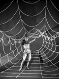Debbie Reynolds Spreading Her Hand in Checkered Top on a Spider Web