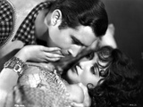 Bebe Daniels Resisting on a Man Trying to Kiss Her in White Dress