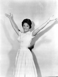 Connie Francis Posed in White Dress with Hands Wide Open