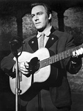 Christopher Plummer Playing Guitar in Black Background
