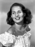 Brenda Marshall on a Ruffled Off Shoulder Top