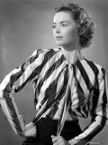 Dorothy McGuire on Stripe Top sitting and Hand on Waist