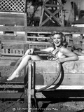 Claire Trevor smiling in Lingerie while Holding Water Hose