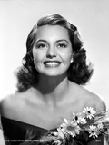 Cyd Charisse smiling in Black Dress with Flowers