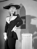 Carole Landis on a Long Sleeve Top standing and posed