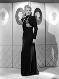 Claire Trevor standing in Black Dress