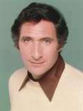 Judd Hirsch Wearing a White Sweater in a Close Up Portrait