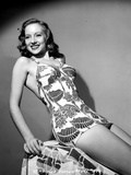 Evelyn Keyes on a Printed Dress and Reclining Pose