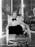 Ida Lupino on a Ruffled Lace Top sitting and posed