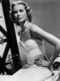 Grace Kelly Curly Hair Hands on Waist wearing White Gown