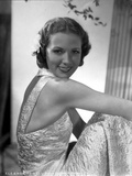 Eleanor Powell on an Embroidered Dress and sitting