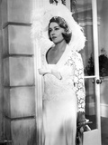 Jeanne Moreau Posed in White V-Neck Sheer Sleeve Lace Silk Dress and Feather Hat