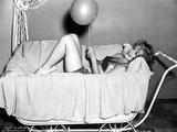 Eva Gabor Lying with a Balloon
