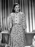 Gracie Allen smiling wearing White Dress with Black Heels