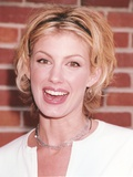 Faith Hill smiling with Red Background
