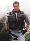 Jason Patric Close Up Portrait in Grey T-Shirt and Grey Jeans with Black Kevlar Vest and Leather Gl