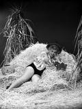 Eva Gabor on a Silk Top Lying on Hay