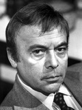 Herbert Lom Looking Serious in Suit With Black and White Background