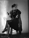 Eva Gabor on a Furry Shawl and Dark Dress sitting