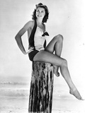 Esther Williams Seated in Swimsuit