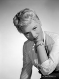Judy Holliday on a Long Sleeve Polo sitting and smiling
