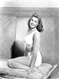 Esther Williams sitting with a Smile in Black and White