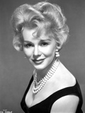 Eva Gabor on a Dress with Pearl Necklace and Earrings