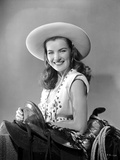 Ella Raines smiling in Cowgirl Outfit