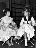 Hayley Mills with a Kid  sitting on a Chair in a Dress