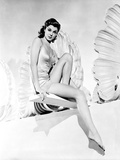 Esther Williams sitting on a Dive Board in Black and White
